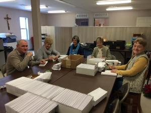 Volunteers Envelope Stuffing